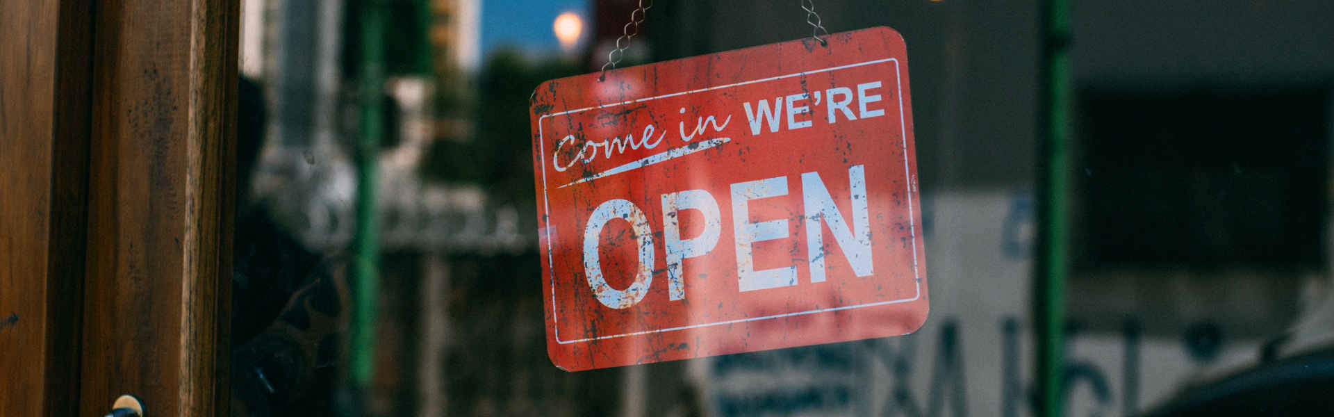 business signage that says come in we're open