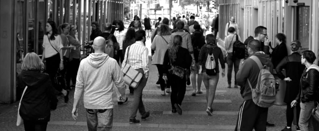 black and white photo of people walking